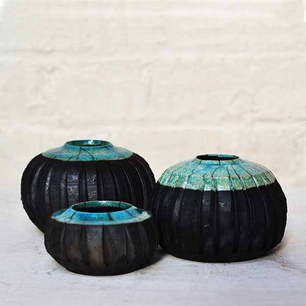 Raku fired pots, these have been thrown on the wheel and textured, glazed in a turquoise crackle glaze