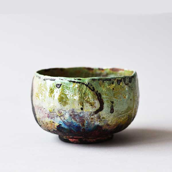 Raku teabowl, hand carved Japanese style and glazed in a blue and turquoise lustre glaze